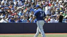 Toronto Blue Jays pitcher Ricky Romero walks to the dugout after being pulled by manager John Farrell during the second inning of their American League baseball game against the Tampa Bay Rays in Toronto September 2, 2012. (MIKE CASSESE/REUTERS)