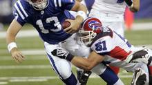 Indianapolis Colts quarterback Jared Lorenzen (13) is tackled by Buffalo Bills linebacker Paul Posluszny (51) during the first quarter of a preseason NFL football game in Indianapolis, Sunday, Aug. 24, 2008. The game is the Colts' first in the new Lucas Oil Stadium. (AP Photo/AJ Mast) (AJ Mast/The Associated Press)