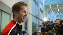 High jump gold medallist Derek Drouin, of Corunna, Ont., speaks to the media as he arrives in Toronto on Aug. 24, 2016. (Chris Young/THE CANADIAN PRESS)