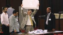 Officers sort the voting results for the selection of Libya's National Congress president and his two deputies during a meeting at a hotel in Tripoli on August 9, 2012. (ESAM OMRAN AL-FETORI/REUTERS)