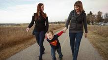 Jacquie Buckley, right, a retired member of the Canadian military, walks with daughter Teresa Steeves, left, and four-year-old grandson Mason Rafuse-Steeves in Calgary, Alta., Tuesday, Nov. 8, 2016. (Jeff McIntosh/THE CANADIAN PRESS)