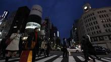 City lights and billboards are turned off at Tokyo's Ginza fashion district on Monday (JIJI PRESS/Jiji Press/AFP Getty Images)