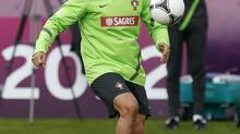 Cristiano Ronaldo plays with a ball during a training session of Portugal at the Euro 2012 soccer championship in Opalenica, Poland, Thursday, June 7, 2012. (Armando Franca/AP)