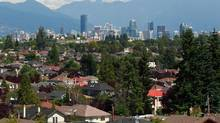 The skyline of Vancouver forms a backdrop for multi-million dollars homes in the Kitsilano and MacKensie Heights neighbourhoods of Vancouver, BC on Aug. 3, 2011. (Jeff Vinnick/The Globe and Mail)