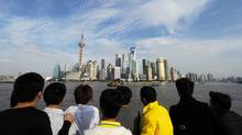 Tourists view the Pudong Financial district skyline from the historic Bund in Shanghai. China has replaced Spain as the world's third most visited country, behind France and the United States, figures from the UN World Tourism Organisation showed recently. (MARK RALSTON/MARK RALSTON/AFP/Getty Images)