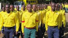 South African firefighters march at a farewell ceremony near Johannesburg on Saturday as they prepare to fly to Canada to help fight the Alberta forest fires. With 300 firefighters in the mission, it is the biggest-ever non-military deployment of South Africans on an overseas mission. (Geoffrey York/The Globe and Mail)