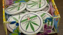 Buttons are displayed at The Dispensary in Vancouver on March 6, 2014. Over the objections of Ottawa, Vancouver is planning to regulate locations of dispensaries and impose a $30,000 business licence on new and existing operations. (JONATHAN HAYWARD/THE CANADIAN PRESS)