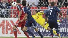 Chicago Fire's Alvado Fernandez (centre left) watches is header beat Toronto FC 's goalkeeper Milos Kocic (centre) to open the scoring as Toronto's Darren O'Dea (left) and Chicago's Sherjill McDonald look on during first half MLS action in Toronto on Wednesday September 12, 2012. (Chris Young/THE CANADIAN PRESS)