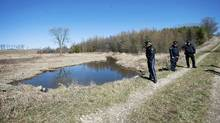 OPP officers are seen at a small creek near the site where Tori Stafford's body was found near Mount Forest, Ont. (Kevin Van Paassen/The Globe and Mail/Kevin Van Paassen/The Globe and Mail)