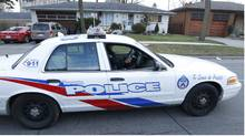 A Toronto Police officer in a supervisor's vehicle. Jan. 11, 2012 (Peter Power/The Globe and Mail)