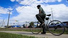 Edmonton still revolves around big cars and wide roads. No new bike lanes will be built before the end of the decade according to the city's current plans. (Codie McLachlan for The Globe and Mail)