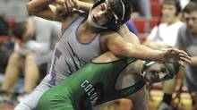 This Jan. 16, 2014 photo shows Keystone High School wrestler Logan Stiner, top, during a match in Sheffield Village, Ohio. A recent autopsy found that the 18-year-old Stiner had a lethal amount of caffeine in his system when he died May 27, 2014. The sudden death of a healthy high school senior has ramped up attention on unregulated caffeine powder and the ease of taking a toxic dose. (Steve Manheim, The Chronicle Telegram/AP)