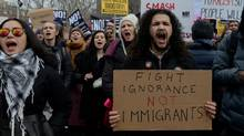 People participate in a protest against U.S. President Donald Trump's immigration policy in New York City on Feb. 11, 2017. (STEPHANIE KEITH/REUTERS)