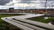 Pipes carry steam to well heads at Cenovus Energy's oil sands operation in Christina Lake, Alta. (Richard Perry/The New York Times)