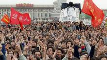 Students shout slogans as they pay respect in Beijing to former Chinese Communist Party leader and liberal reformer Hu Yaobang (CATHERINE HENRIETTE)