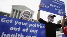 Doctors protest against President Obama's health care reform in front of the U.S. Supreme Court in Washington. (Yuri Gripas/REUTERS)