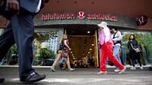 People walk past a store of yogawear retailer Lululemon Athletica in downtown Vancouver June 11, 2014. (BEN NELMS/REUTERS)