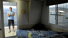 Keith Newcomb of Kelowna has had a houseboat on Okanagan Lake since 1983, and feels people discriminate against houseboaters because of a perception that they're 'trailer trash.' (Daniel Hayduk for The Globe and Mail)