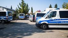 Police cars are seen in Rottenburg am Neckar, on April 21, 2017 following an arrest of a man in connection with the bomb attack on Dortmund's team bus. (CHRISTOPH SCHMIDT/AFP/Getty Images)