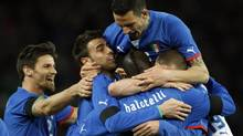 Italy's Mario Balotelli (C) celebrates scoring a goal with teammates during their international friendly soccer match against Brazil at the Stade de Geneve in Geneva March 21, 2013 (DENIS BALIBOUSE/REUTERS)