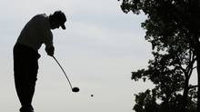 Silhouette of a golfer