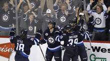 If a pair of U.S. economists are right, officials should face more pressure at the MTS Centre in Winnipeg, packed full of rabid pro-Jets fans, than they did in the Philips Arena in Atlanta. (JOHN WOODS/JOHN WOODS/THE CANADIAN PRESS)