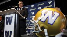 Murray Taylor, President and CEO of Investors Group and The Winnipeg Blue Bombers speaks during a press conference in Winnipeg Wednesday, December 14, 2011 (John Woods)