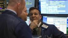 Traders work on the floor of the New York Stock Exchange March 17, 2014. (BRENDAN MCDERMID/REUTERS)
