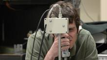 Graeme Williams was a third-year engineering student in May, 2009, at the University of Waterloo, whose area of focus incorporates electrical, chemical and computer engineering. He is seen here in one of his research labs on the university campus.