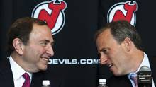Joshua Harris, right, talks with NHL commissioner Gary Bettman on Thursday. (EDUARDO MUNOZ/REUTERS)