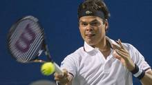 Milos Raonic of Canada returns the ball against John Isner of the United States during Rogers Cup quarterfinal tennis action in Toronto on Friday, August 10, 2012. (Nathan Denette/THE CANADIAN PRESS)