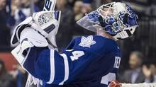 Toronto Maple Leafs goaltender James Reimer celebrates after saving a shot from Washington Capitals' Troy Brouwer (not shown) to win during shootout NHL hockey action in Toronto on Saturday November 23, 2013. (The Canadian Press)