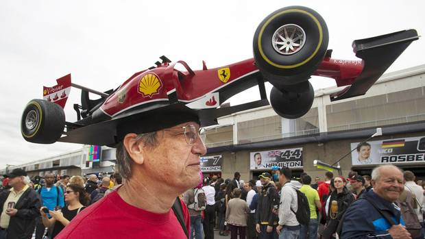 Kim Reimer, from Tallahassee, Fla., wears a Ferrari car hat at Circuit Gilles Villeneuve, Thursday, June 5, 2014 in Montreal. (Ryan Remiorz/THE CANADIAN PRESS)