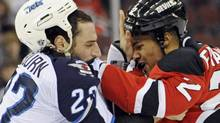 New Jersey Devils' Mark Fraser, right, fights with Winnipeg Jets' Chris Thorburn during the first period of an NHL hockey game, Saturday, Nov. 5, 2011, in Newark, N.J. (AP Photo/Bill Kostroun) (Bill Kostroun)