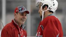 Washington Capitals' Alex Ovechkin, right, of Russia, talks with coach Adam Oates during NHL hockey team practice at the Kettler Capitals Iceplex in Arlington, Va. Wednesday, May 1, 2013. (Susan Walsh/AP)