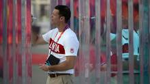 Canadian Olympian and Chef De Mission Mark Tewksbury signs a glass pillar as he takes part in a welcoming ceremony in the Athletes Village at the 2012 Summer Olympics in London on Wednesday, July 25, 2012. (Sean Kilpatrick/THE CANADIAN PRESS)