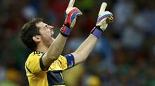 Spain's goalkeeper Iker Casillas celebrates after third goal, scored by Fernando Torres (not pictured) during their Euro 2012 final soccer match against Italy at the Olympic stadium in Kiev, July 1, 2012. (Eddie Keogh/REUTERS)