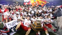 Laval University Rouge et Or's celebate with the Vanier Cup after defeating the McMaster University Marauders in CIS football action at the 48th Vanier Cup championship game in Toronto on Friday, Nov. 23, 2012 (CP)