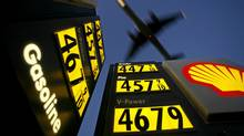 Gasoline prices are advertised at a gas station near Lindbergh Field as a plane approaches to land in San Diego, California, in this file picture taken June 1, 2008. (MIKE BLAKE/REUTERS)