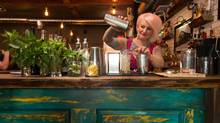 One of Chartier's top-notch staff pours a drink at the bar of the new Beaumont, Alta., restaurant. The business began as a Kickstarter – the first successful restaurant campaign in Alberta and one of the most successful across the country. (Amber Bracken for The Globe and Mail)