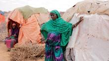 A nine-month pregnant displaced woman, Amina Ali, stands beside her shelter at a makeshift settlement in Bardihahle near Burao, northwestern Togdheer region of Somaliland, on March 26, 2017. (ZOHRA BENSEMRA/REUTERS)