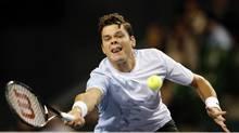 Milos Raonic rushes to the net (Shuji Kajiyama/AP)