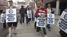 Striking Library workers picket outside the Toronto Reference Library on Monday, March 19, 2012. (Fred Lum/Fred Lum / The Globe and Mail)