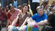 Melinda and Bill Gates interact with villagers during a trip to Patna district in India's Bihar's state on March 23, 2011. (HO/HO/AFP/Getty Images)