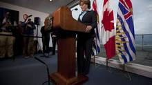 British Columbia Premier Christy Clark pauses during a news conference in Vancouver on Sept. 24, 2012. (JONATHAN HAYWARD/THE CANADIAN PRESS)