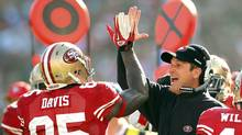 San Francisco 49ers tight end Vernon Davis (L) is congratulated by head coach Jim Harbaugh after his first quarter touchdown catch during their NFL NFC Divisional playoff football game in San Francisco, California January 14, 2012. (BECK DIEFENBACH/REUTERS)