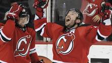 New Jersey Devils' Ilya Kovalchuk celebrates with teammate Travis Zajac (L) after scoring against the Florida Panthers during the second period of Game 6 of their NHL Eastern Conference quarter final playoff hockey game in Newark, April 24, 2012. REUTERS/Ray Stubblebine (RAY STUBBLEBINE)