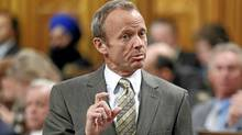 Treasury Board President Stockwell Day speaks during Question Period in the House of Commons on Parliament Hill in Ottawa April 13, 2010. (CHRIS WATTIE/REUTERS)