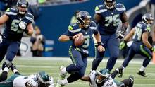 Quarterback Russell Wilson #3 of the Seattle Seahawks tries to evade the Philadelphia Eagles defense at CenturyLink Field on November 20, 2016 in Seattle, Washington. (Steve Dykes/Getty Images)