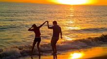 Sundown along the Baboa Peninsula in Newport Beach, Calif .